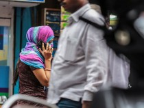 A woman talks on a mobile phone in Mumbai, India, on Saturday, Feb. 28, 2015. The government auction of telecom wireless spectrum starting March 4 is expected to raise as much as $15.6 billion from service providers including those controlled by billionaires Kumar Mangalam Birla, Sunil Mittal and Anil Ambani, according to ICRA Ltd. Photographer: Dhiraj Singh/Bloomberg